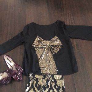 Black with gold bow in the back long sleeve shirt
